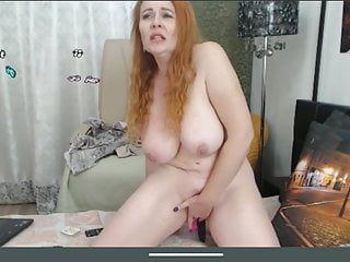 Nice-looking redhead aged with large meatballs masturbates