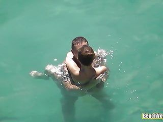 Sexy nude legal age teenager teasing her boyfriend in the water