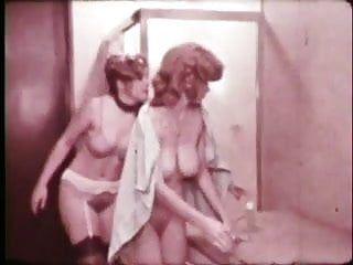 Breasty redhead in lesbo scene