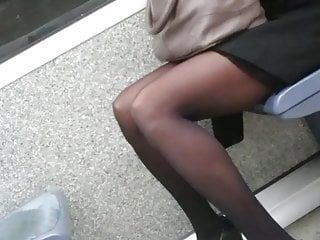 Candid working woman in dark tights hose in the tube